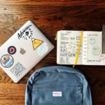 backpack and notebooks with pencil